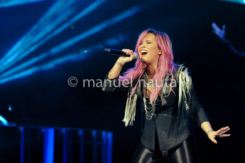 "Demi Lovato on her ""NEON LIGHTS TOUR"" performs at The Toyota Center in Houston"