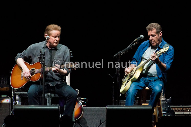 "Don Henley (L) and Glenn Frey with the Eagles perform in concert on the ""History Of The Eagles"" tour at the Toyota Center on February 21, 2014 in Houston, Texas - USA"