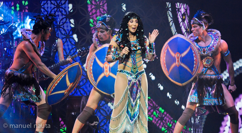 """Cher performs onstage during her """"Dressed To Kill"""" tour at the Toyota Center on March 24, 2014 in Houston, Texas. © Manuel Nauta"""