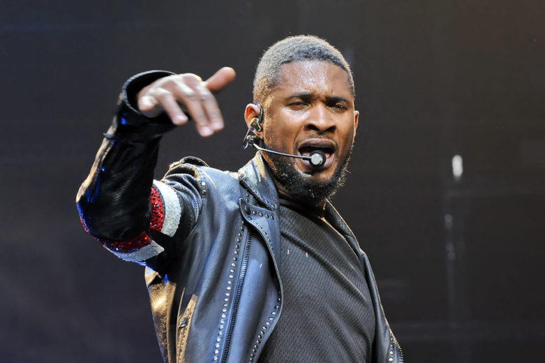 Usher Terry Raymond IV known as Usher perfoms in concert at the Toyota Center on December 5, 2014 in Houston, Texas.