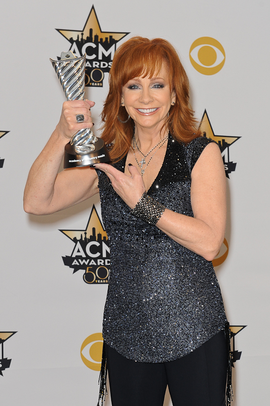 Honoree Reba McEntire, recipient of the Milestone Award for Most Awarded ACM Female Vocalist Of The Year poses in the press room at the 50th Academy Of Country Music Awards at AT&T Stadium on April 19, 2015 in Arlington, Texas. Photo © Manuel Nauta