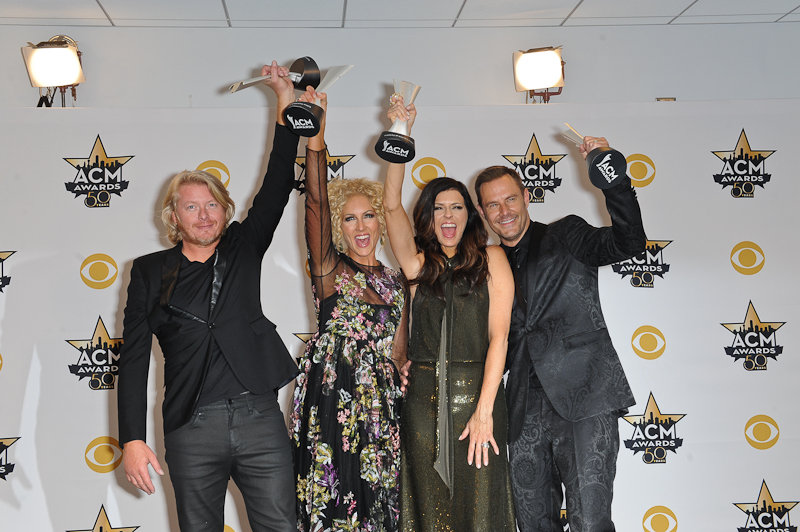 (L-R) Musicians Phillip Sweet, Kimberly Schlapman, Karen Fairchild and Jimi Westbrook of Little Big Town, winners of the Vocal Group of the Year pose in the press room at the 50th Academy Of Country Music Awards at AT&T Stadium on April 19, 2015 in Arlington, Texas. Photo © Manuel Nauta