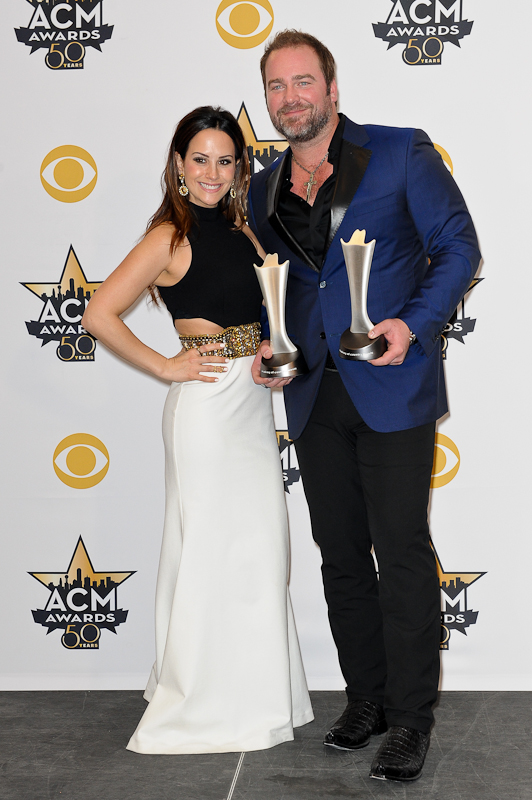 Sara Reeveley (L) kisses singer Lee Brice, winner of the Single Record of the Year Award for 'I Don't Dance', in the press room at the 50th Academy Of Country Music Awards at AT&T Stadium on April 19, 2015 in Arlington, Texas. Photo © Manuel Nauta