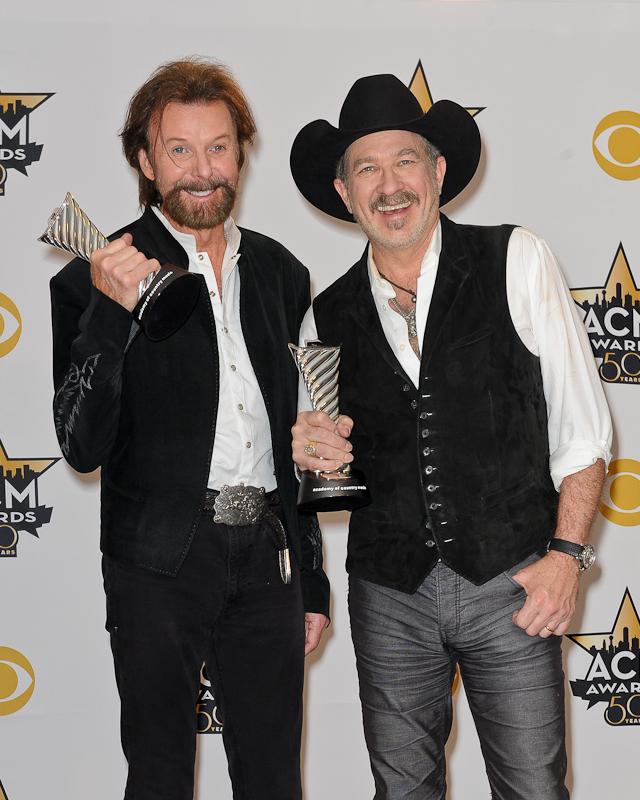 Musicians Ronnie Dunn (L) and Kix Brooks of Brooks & Dunn, recipients of the Milestone Award for Most Awarded Artist pose in the press room at the 50th Academy Of Country Music Awards at AT&T Stadium on April 19, 2015 in Arlington, Texas. Photo © Manuel Nauta