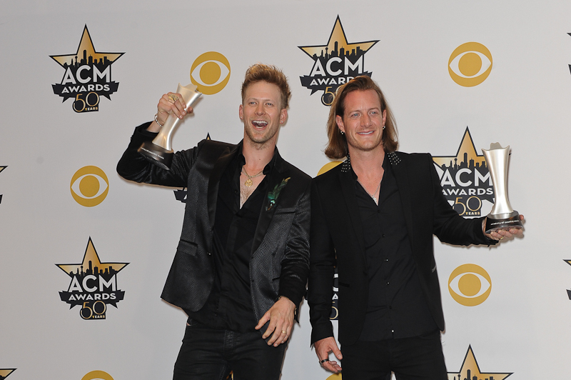 Musicians Brian Kelley (L) and Tyler Hubbard of Florida Georgia Line, winners of Vocal Duo of the Year Award; and Vocal Event of the Year for 'This Is How We Roll', pose in the press room at the 50th Academy Of Country Music Awards at AT&T Stadium on April 19, 2015 in Arlington, Texas. Photo © Manuel Nauta