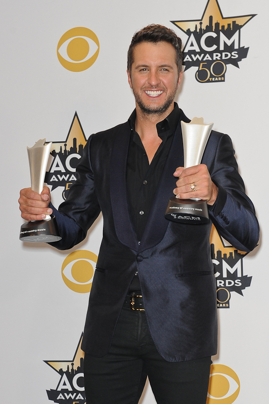 Musician Luke Bryan, winner of the Entertainer of the Year Award; and Vocal Event of the Year Award for 'This Is How We Roll', poses in the press room at the 50th Academy Of Country Music Awards at AT&T Stadium on April 19, 2015 in Arlington, Texas. Photo © Manuel Nauta