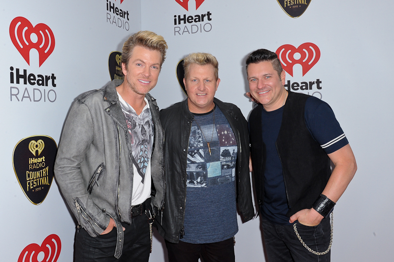 Singers J.D. Rooney, Gary LeVox and Jay DeMarcus of Rascal Flatts pose backstage at the 2015 iHeartRadio Country Festival at The Frank Erwin Center on May 2, 2015 in Austin, Texas.  Photo © Manuel Nauta