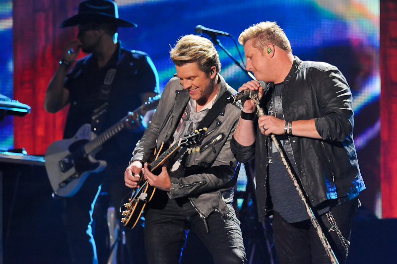 Musicians J.D. Rooney and Gary LeVox of Rascal Flatts perform onstage during the 2015 iHeartRadio Country Festival at The Frank Erwin Center on May 2, 2015 in Austin, Texas.