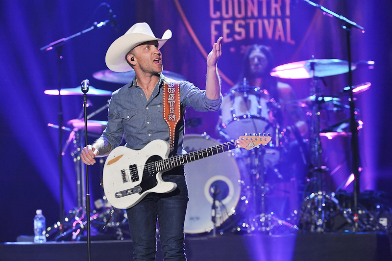 Recording artist Justin Moore performs onstage during the 2015 iHeartRadio Country Festival at The Frank Erwin Center on May 2, 2015 in Austin, Texas.  Photo © Manuel Nauta