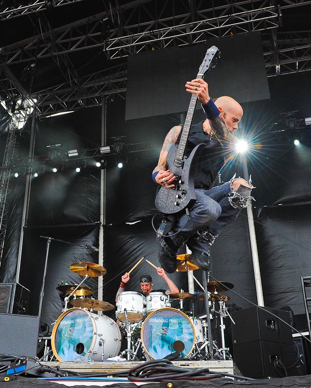 Mike Luce and C.J. Pierce  with Drowning Pool perform onstage during River City Rockfest at the AT&T Center on May 24, 2015 in San Antonio, Texas. Photo © Manuel Nauta