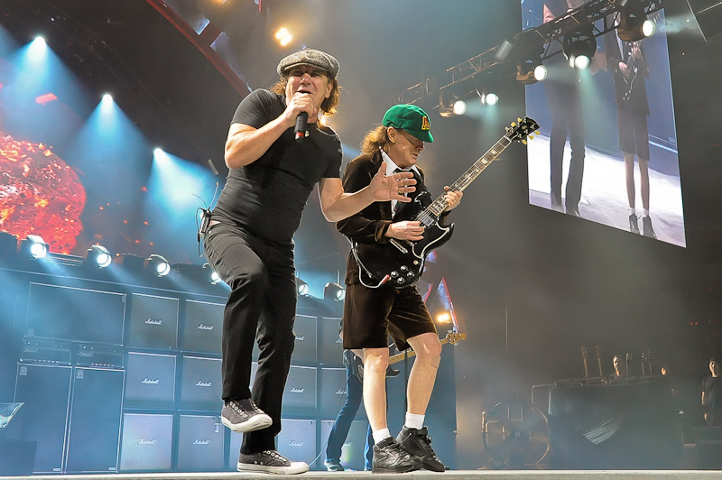 Brian Johnson (L) and Angus Young perform with AC/DC on the Rock or Bust Tour at the American Airlines Center on February 23, 2016 in Dallas, Texas. Photo © Manuel Nauta