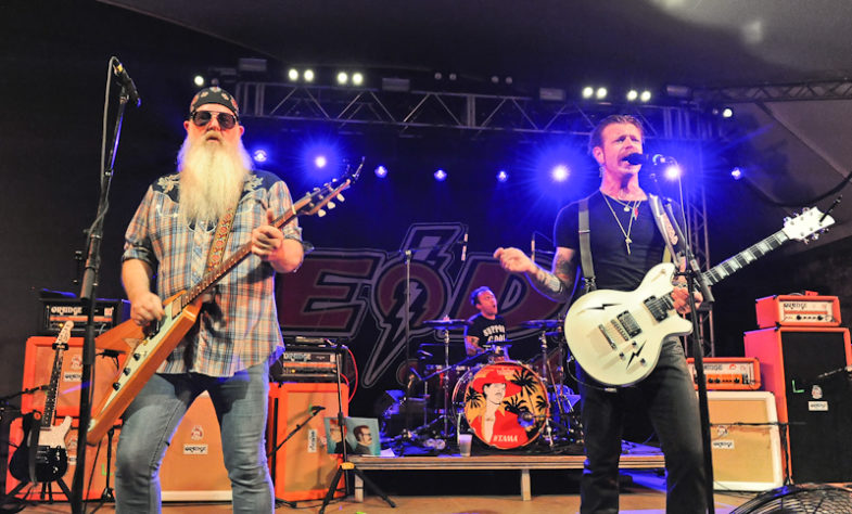 (L-R) Dave Catching, Jorma Vic, and Jesse Hughes of the band Eagles of Death Metal perform in concert at Stubb's on May 21, 2016 in Austin, Texas. Photo © Manuel Nauta