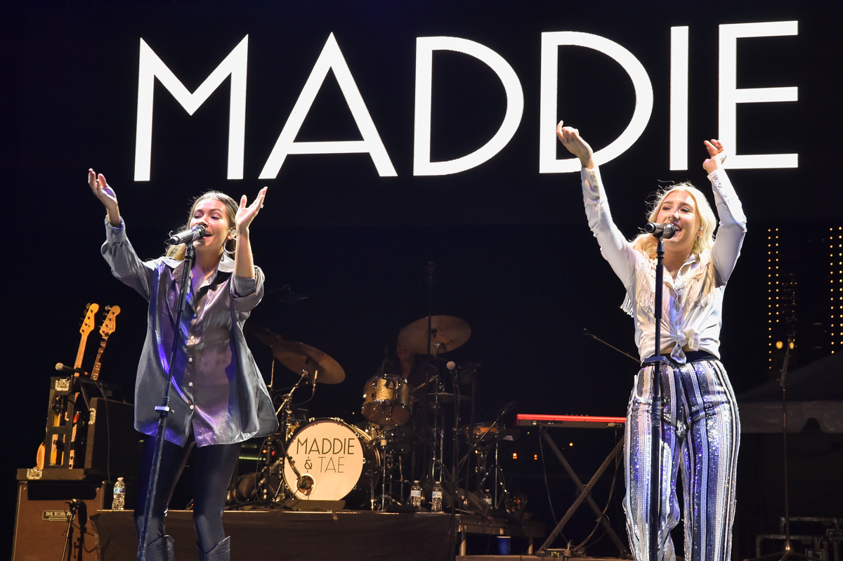 Taylor Dye (L) and Maddie Marlow (R) with the band Maddie and Tae perform in concert during the River and Blues Festival at the Panther Island Pavilion in Fort Worth Texas on November 14, 2020. Photo © Manuel Nauta