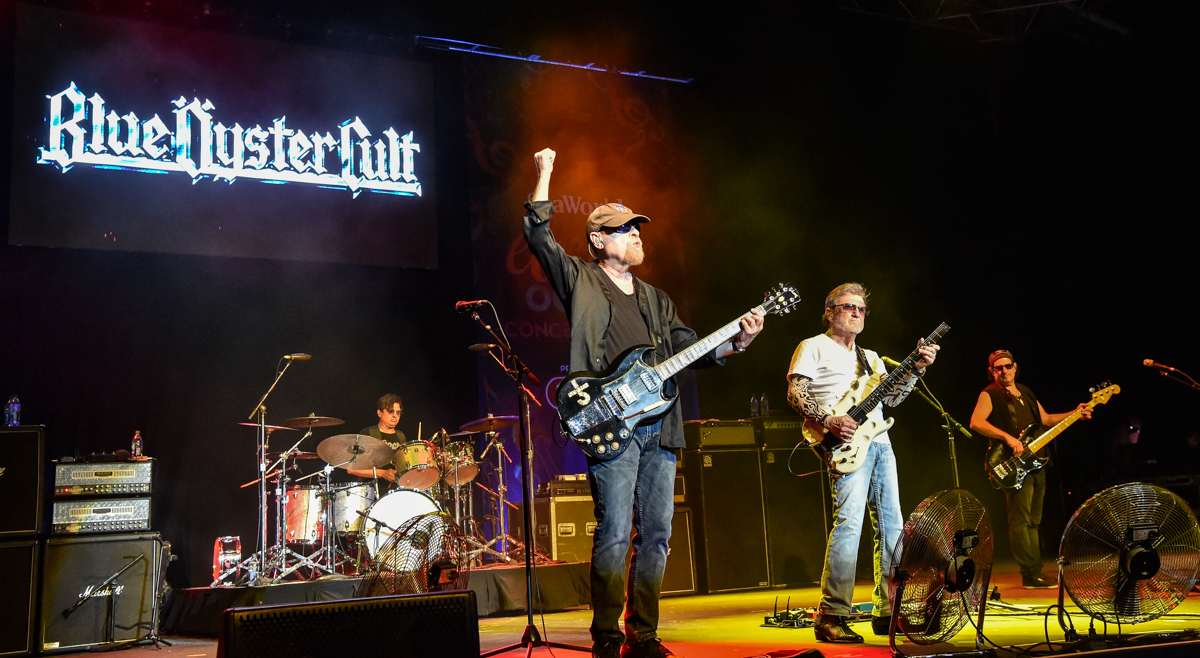 """(L-R) Jules Radino, Eric Bloom, Donald """"Buck Dharma"""" Roeser and Danny Miranda perform in concert with Blue Oyster Cult at the SeaWorld Electric Ocean Concert Series in San Antonio, Texas on August 1, 2021 / Photo © Manuel Nauta"""